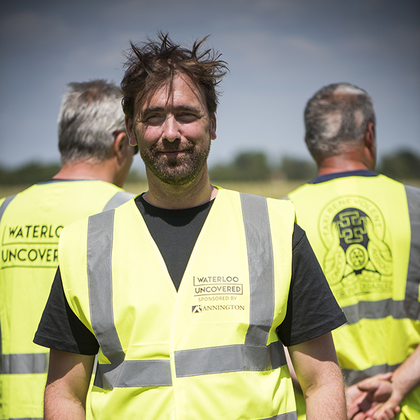 Mark Evans, CEO of Waterloo Uncovered, on site in Belgium wearing a yellow high vis jacket